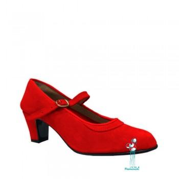 zapato rojo en piel con una correa